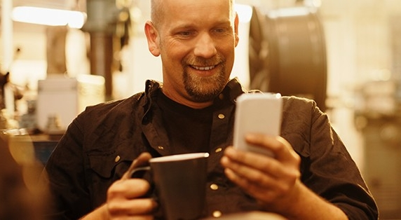 Man-Looking-at-Cellphone-Thumbnail