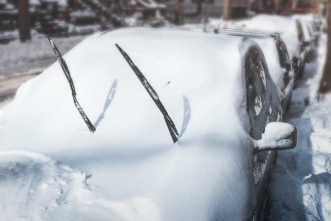 snow-covered-car-with-wipers-up