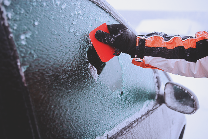 Scraping-Ice-Off-Window-With-Credit-Card