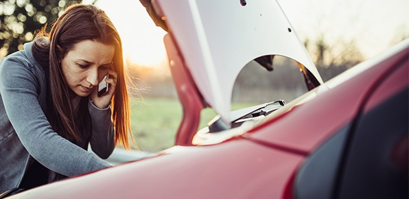 Female-Driver-On-Phone-Inspecting-Car-Engine