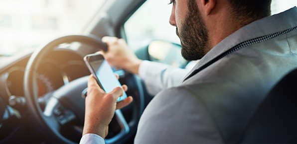 Male-Using-Phone-While-Driving