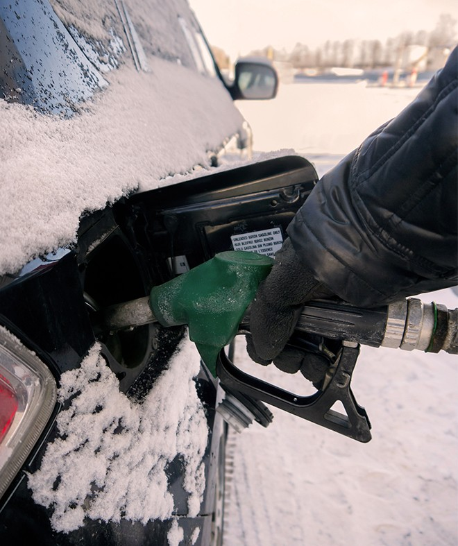 pumping-gas-in-the-winter-snow