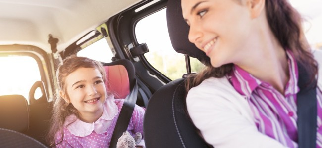 Mom-in-Driver-Seat-Looking-Back-at-Young-Girl