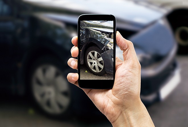 person-taking-picture-of-car-crash